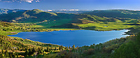 Catamount Lake gleams like a sapphire against the lush green carpet of the Yampa Valley in spring.