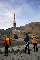 Ecotourists visiting Pyramiden abandoned Russian mining town on Spitzbergen. Guides must carry a weapon as protection from Polar bears