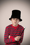 Young expressive magician with vintage colors and effects