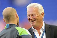 New York Red Bulls head coach Hans Backe talks with Freddie Ljungberg (10) of the Seattle Sounders before the game. The Seattle Sounders defeated the New York Red Bulls 1-0 during a Major League Soccer (MLS) match at Red Bull Arena in Harrison, NJ, on May 15, 2010.