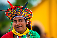 """A native from the Kamentsá tribe, wearing a colorful headgear, smiles during the Carnival of Forgiveness, a traditional indigenous celebration in Sibundoy, Colombia, 12 February 2013. Clestrinye (""""Carnaval del Perdón"""") is a ritual ceremony kept for centuries in the Valley of Sibundoy in Putumayo (the Amazonian department of Colombia), a home to two closely allied indigenous groups, the Inga and Kamentsá. Although the festival has indigenous origins, the Catholic religion elements have been introduced and merged with the shamanistic tradition. Celebrating annually the collaboration, peace and unity between tribes, they believe that anyone who offended anyone may ask for forgiveness this day and all of them should grant pardons."""