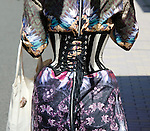 Japanese woman in Harajuku wears a fashionable external corset.