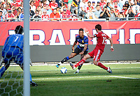 Manchester United midfielder Nani (17) cuts back against Chicago Fire defender Gonzalo Segares (13) as goalkeeper Jon Conway (1) prepares for a shot.  Manchester United defeated the Chicago Fire 3-1 at Soldier Field in Chicago, IL on July 23, 2011.