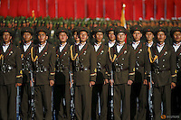 Soldiers listen to North Korean leader Kim Jong Un addressing the parade celebrating the 70th anniversary of the founding of the ruling Workers' Party of Korea, in Pyongyang October 10, 2015. Isolated North Korea marked the 70th anniversary of its ruling Workers' Party on Saturday with a massive military parade overseen by leader Kim Jong Un, who said his country was ready to fight any war waged by the United States.   REUTERS/Damir Sagolj  - RTS3UZ6