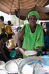 A woman sells bowls of tapioca in milk near the Grand Marche of Bamako, Mali.