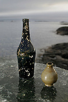 Wine bottel and a small piece of ceramic, taken on land just a few hundred meters from where the ship sank. ©Fredrik Naumann/Felix Features