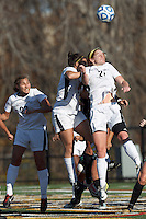 College of St Rose forward Laura Taylor (21) heads the ball on a corner kick.. In 2012 NCAA Division II Women's Soccer Championship Tournament First Round, College of St Rose (white) defeated Wilmington University (black), 3-0, on Ronald J. Abdow Field at American International College on November 9, 2012.