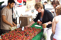 Strawberries on sale from Phillips Farm in Milford.<br /> <br /> <br /> &copy; Clay Williams / http://claywilliamsphoto.com