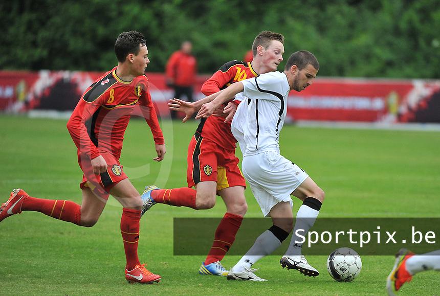 Georgia U19 - Belgium U19 : Guram Samushia (7) and Birger Verstraete (8) with Rob Schoofs (behind)<br /> foto DAVID CATRY / Nikonpro.be