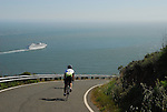 Bicyclist and cruise ship leaving San Francisco Bay
