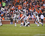 Ole Miss' Brandon Bolden (34) is tackled by Auburn linebacker Eltoro Freeman (21) at Jordan-Hare Stadium in Auburn, Ala. on Saturday, October 29, 2011. Auburn won 41-23..