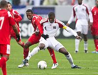 CARSON, CA - March 25, 2012: Victor Barrera (9) of Panama and Sheldon Bateau (4) of Trinidad & Tobago during the Panama vs Trinidad & Tobago match at the Home Depot Center in Carson, California. Final score Panama 1, Trinidad & Tobago 1.