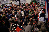 Moscow, Soviet Union<br /> August 24, 1991<br /> <br /> The body of a martyr is lowered into the ground following the Soviet coup d'&eacute;tat attempt (August 19-21, 1991), also known as the August Putsch or August Coup. A small group of the Soviet government officials briefly deposed president Mikhail Gorbachev in an attempted to take control of the country. The coup leaders were hard-line members of the Communist Party (CPSU) who felt that Gorbachev's reforms had gone too far in dispersing the central government's power to the republics - better known as perestroika. The coup collapsed in three days, and Gorbachev returned to power, crushing the Soviet leader's hopes that the union could be held together in a decentralized form.