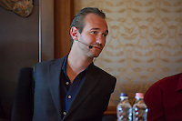 Nick Vujicic born without legs and arms attends a press conference during his visit to deliver his teachings about hope in Budapest, Hungary on April 18, 2013. ATTILA VOLGYI