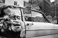 Manhattan, New York City, NY. December 1969.<br /> A van with American flags and a picture of John Wayne on the side during a Black Panthers demonstration in December 1969. The demonstration was in memory of Black Panther Fred Hampton who was killed in a Chicago raid because he was suspected of plotting to assassinate Federal leaders.