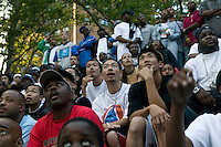Members of the Far East Ballers, a Japanese street basketball team, watch a game at the Kingdome tournament in Harlem, New York City, USA, June 18 2005.