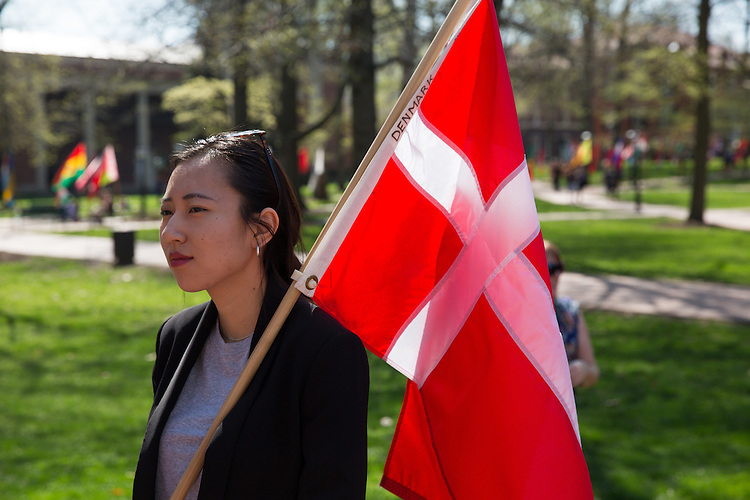 Mingran Ma, junior photojournalism major, holds the flag of Denmark. Ma is a student leader for the International Studies department.