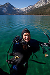 UC Davis researcher Brant Allen surfaces in Emerald Bay after collecting Asian clams, an invasive species to Lake Tahoe at Camp Richardson, Calif., October 30, 2012