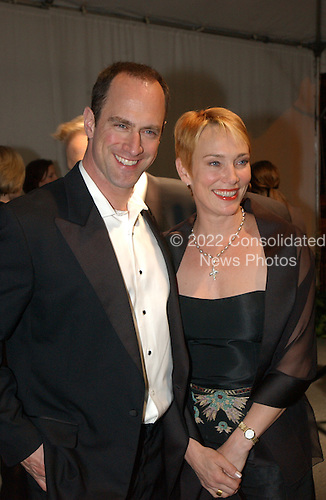 """Christopher Meloni, star of the NBC series """"Law and Order: Special Victims Unit"""" and his wife, Doris, arrive for the party hosted by Bloomberg News following the 2003 White House Correspondents Dinner in Washington, DC on April 26, 2003..Credit: Ron Sachs / CNP"""