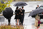 Washington, DC - September 11, 2009 -- A Soldier escorts First Lady Michelle Obama from the motorcade to the Pentagon Memorial just before the 9/11 Remembrance ceremony September 11, 2009. United States President Barack Obama, Secretary of Defense Robert Gates and Admiral Michael Mullen, chairman of the Joint Chiefs of Staff spoke at the event to families of the victims at the Pentagon.     .Mandatory Credit: Alex McVeigh - DoD via CNP