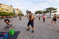 Phnom Penh, Cambodia. Morning sports along Preah Sisowath Quay.<br /> Disco dancing.