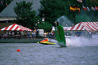 Frame 9: Halfway around the first lap, Wyatt Nelson (#39) blows the boat over crashing back to the water. Nelson was unhurt in the crash. (SST-120 class) Bay City, MI 1998