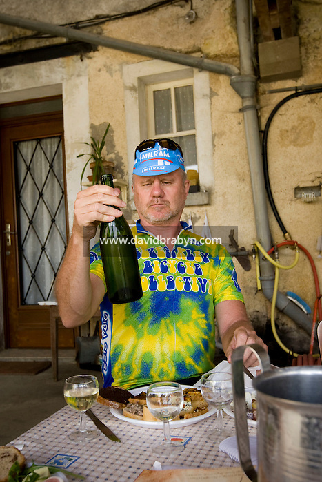 Writer David Darlington, participant in a Backroads cycle tour of the Loire Valley, examines a bottle of wine at Daniel Jarry's cellars in Vouvray, France, 26 June 2008.
