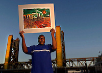 Ray Franklin, 56, is a talented and prolific artist with schizophrenia whose art is collected and featured in museums and galleries. He practices his art at the the Short Center South, a fine arts program for people with disablities. The Tower bridge is a recurring theme in his paintings.  September 9,  2004