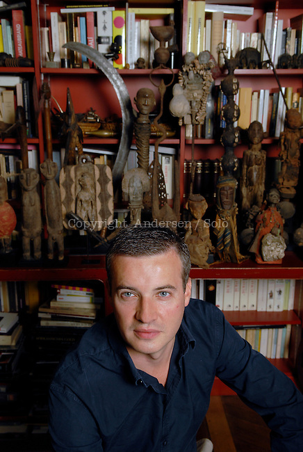 Emmanuel Pierrat at home with his collection of african art.