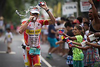 Craig Alexander cools off at the aid station on the run at the 2013 Ironman World Championship in Kailua-Kona, Hawaii on October 12, 2013.