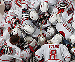 3/11/05 Omaha Neb.  Members of University of  Nebraska at Omaha hockey team gather around goalie Chris Holt University of  Nebraska at Omaha the start of Friday night's game at the Qwest Center Omaha. UNO won the first game of the CCHA play-offs.(chris machian/Prarie Pixel Group)