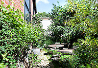 Tranquil garden spaces have been created amongst the old industrial buildings
