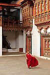 Asia, Bhutan, Punakha. Monk at Punakha Dzong.
