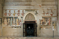 Low angle view of wall with frescoes, 14th century, and doorway,  Chiesa S. Giorgetto dei Domenicani, also known as S. Pietro Martire, 1283, Verona, Italy. The Church, built by the Dominicans, contains  14th century frescoes which were covered over during the 19th century and damaged when the layer of plaster was later removed. They depict the Brandenburg Knights who arrived in Verona in 1354 to work with Cangrande II. Picture by Manuel Cohen.