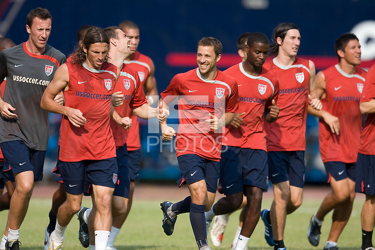 Steve Cherundolo, center, laughs during the USA practice in Cuba, at the Estadio Nacional De Futbol Pedro Marrero Friday, Sept. 4, 2008.