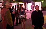 Attendees of Tuesday's viewing party for the 2011 Victoria's Secret Fashion Show watch celebrity arrivals on the Pink Carpet while waiting for the show to start.