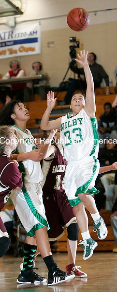 WATERBURY, CT, 12/16/08- 121608BZ10-  Wilby's Adriana Mojica (33) goes to the hoop with teammate Kristian Parker (32) against Sacred Heart's Paige Topazio (21) and Lauren Ericson (15) during their game at Wilby Tuesday night. <br /> Jamison C. Bazinet Republican-American