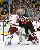 Edwin Shea (BC - 8), John Muse (BC - 1), Tyler McNeely (Northeastern - 94) - The Boston College Eagles defeated the Northeastern University Huskies 5-4 in their Hockey East Semi-Final on Friday, March 18, 2011, at TD Garden in Boston, Massachusetts.