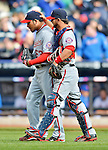 11 April 2012: Washington Nationals catcher Jesus Flores congratulates pitcher Henry Rodriguez after a game against the New York Mets at Citi Field in Flushing, New York. The Nationals shut out the Mets 4-0 to take the rubber match of their 3-game series. Mandatory Credit: Ed Wolfstein Photo