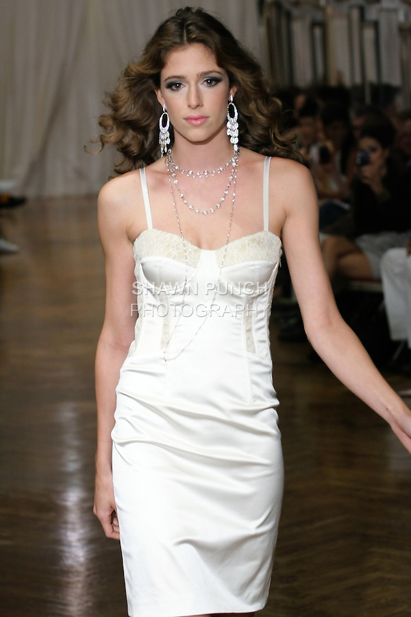 """Model walks the runway in an outfit by Adrienne Zernich for her Adrienne Zernich Spring 2011 """"Romantic Garden Party"""" collection, at the National Arts Club on September 14, 2010."""