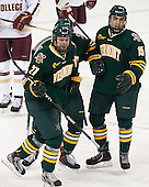 Anders Franzon (UVM - 27), Colin Markison (UVM - 6) and Yvan Pattyn (UVM - 15) celebrate Franzon's goal which put Vermont on the board first. - The Boston College Eagles defeated the University of Vermont Catamounts 4-1 on Friday, February 1, 2013, at Kelley Rink in Conte Forum in Chestnut Hill, Massachusetts.