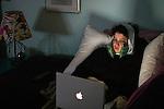 &copy;2007  David Burnett/ <br /> photographer: David Burnett<br /> 1/12/07<br /> <br /> Jordan Kai Burnett at home with ice packs after having had wisdom teeth pulled 1/11/07<br /> looking at email on laptop<br /> watching tv