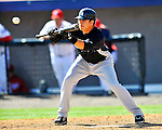 12 March 2011: New York Yankees' infielder Ramiro Pena lays down a bunt during a Spring Training game against the Washington Nationals at Space Coast Stadium in Viera, Florida. The Nationals edged out the Yankees 6-5 in Grapefruit League action. Mandatory Credit: Ed Wolfstein Photo