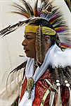 Portrait of D.Salvatore Timberwolf Lamia dressing in traditional regalia, Tribal Ancestry: Shinnecock Indian Nation, Paukatuck Eastern Pequot. Intertribal Dancing a celebration of ethnic Native American pride and heritage  at Thunderbird Pow Wow.<br /> release # 2276, # 2452<br /> <br /> A pow-wow (also powwow or pow wow or pau wau) is a gathering of North America's Native people. The word derives from the Narragansett word powwaw, meaning &quot;spiritual leader&quot;.