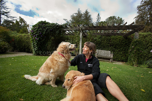 Stanford women's basketball coach, Tara VanDerveer at her home in Menlo Park, California. Playing piano and with her two dogs.