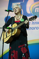 Moscow, Russia, 02/11/2011..A competitor sings at the first Moscow Super-Babushka contest. A total of 105 women aged over 50 entered to compete for various titles, including most stylish, modern, elegant, business-minded, creative, artistic, and cheerful granny. The overall winning title of Super-Babushka was taken by 73 year old Ludmilla Trafinovna in the event organised by the Moscow City Government Social Welfare Department.