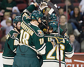 The Catamounts celebrate Drew MacKenzie's (Vermont - 2) goal. - The visiting University of Vermont Catamounts tied the Boston University Terriers 3-3 in the opening game of their weekend series at Agganis Arena in Boston, Massachusetts, on Friday, February 25, 2011.