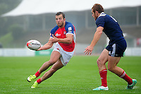 James Beal of Great Britain passes the ball. FISU World University Championship Rugby Sevens Men's Semi Final between Great Britain and France on July 9, 2016 at the Swansea University International Sports Village in Swansea, Wales. Photo by: Patrick Khachfe / Onside Images