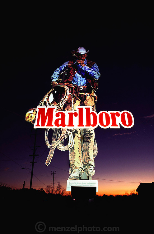 Illuminated Marlboro Man sign at dusk. Rosamond, Edwards Air Force Base, California, USA.