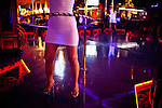 A sex worker twirls a hula hoop at the Mustang Ranch in Sparks, Nev. November 26, 2012.